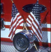 Photo of flags on front of firetruck