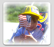 Photo of boy waving flag in stoller